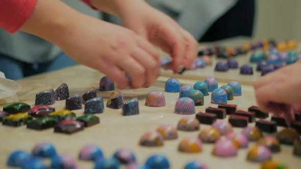 Thumbnail for Set of Colorful Luxury Handmade Bonbons on White Table. Exclusive Handcrafted Chocolate Candy