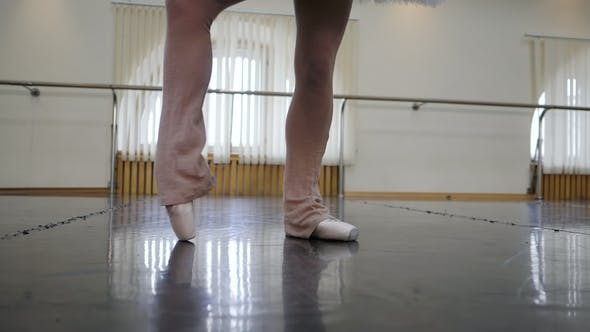 Thumbnail for Ballerina in Ballet Shoes Pointe Stretches on Barre in Class. . Woman Practicing in Dance Studio