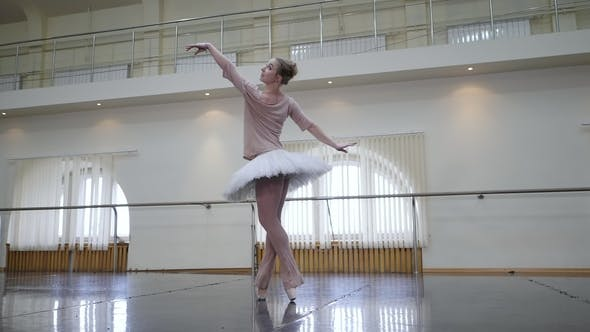 Thumbnail for Ballerina in White Ballet Tutu Dress Practicing in Dance Studio or Gym. Woman Dancing Classical Pas