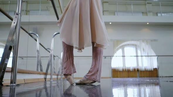 Thumbnail for Ballerina in Ballet Shoes Pointe Stretches on Barre in Gym. Woman Practicing in Dance Studio