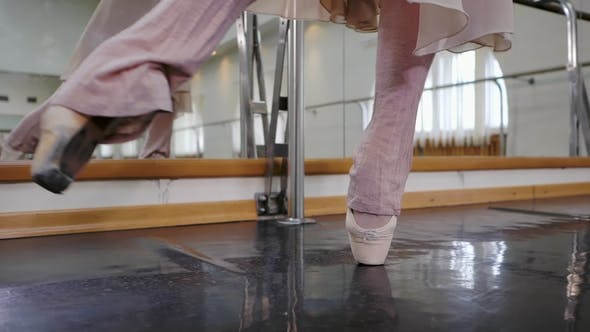 Thumbnail for Ballerina in Ballet Shoes Pointe Stretches on Barre in Gym. . Woman Practicing in Dance Studio. Work