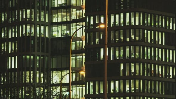 Thumbnail for People Working in Tall Office Building with Street Lamps