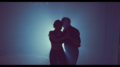 Professional Dancers Dancing in Ballroom Silhouette