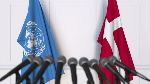 Thumbnail for Flags of the United Nations and Denmark at International Press Conference