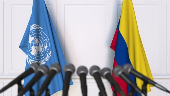 Thumbnail for Flags of the United Nations and Colombia at International Press Conference