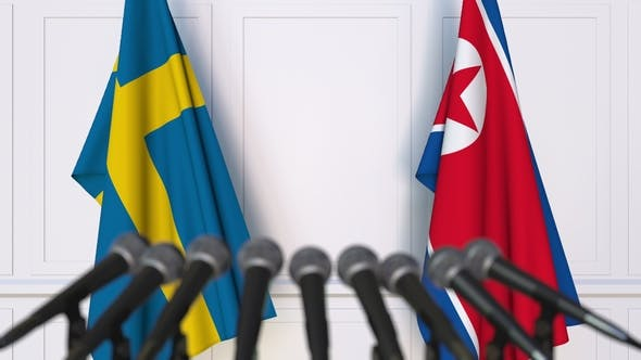 Thumbnail for Flags of Sweden and North Korea at International Press Conference