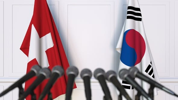 Thumbnail for Flags of Switzerland and Korea at International Press Conference