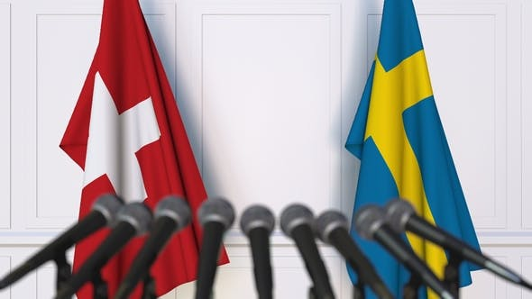 Thumbnail for Flags of Switzerland and Sweden at International Press Conference