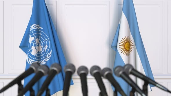 Thumbnail for Flags of the United Nations and Argentina at International Press Conference