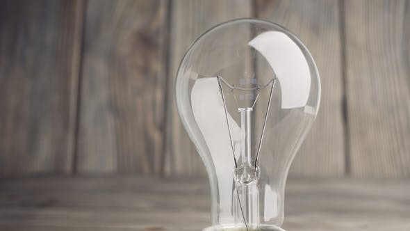 Thumbnail for Light Bulb on Wood Background