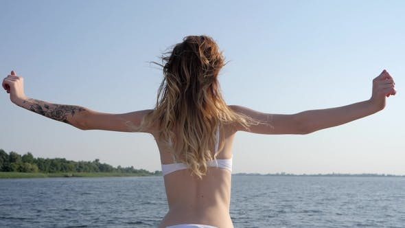 Thumbnail for Girl in Swimsuit Raises Hands up on Yacht in Summer Season