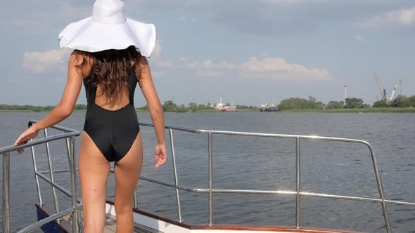 Thumbnail for Female in White Hat and Black Swimsuit Waving Hair and Smiling in Summer