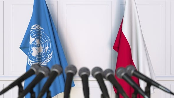 Thumbnail for Flags of the United Nations and Poland at International Press Conference
