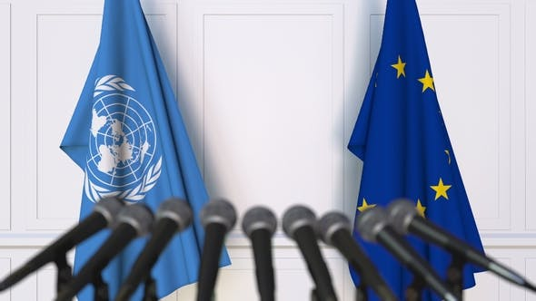 Thumbnail for Flags of the United Nations and the European Union at International Press Conference
