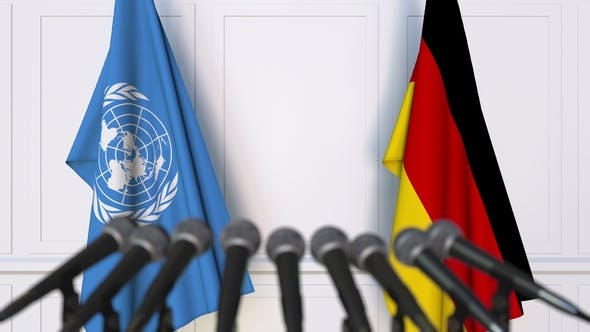 Thumbnail for Flags of the United Nations and Germany at International Press Conference