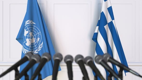 Thumbnail for Flags of the United Nations and Greece at International Press Conference