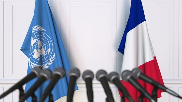 Thumbnail for Flags of the United Nations and France at International Press Conference