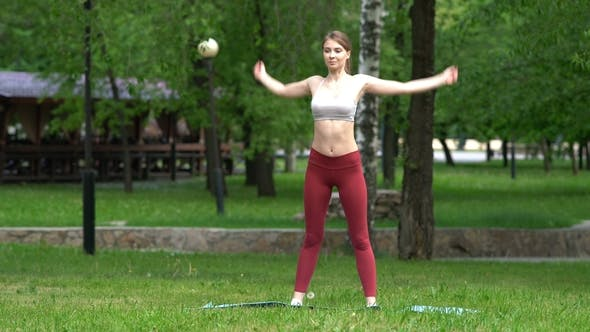 Thumbnail for Young Girl Doing Yoga Exercises in the Park