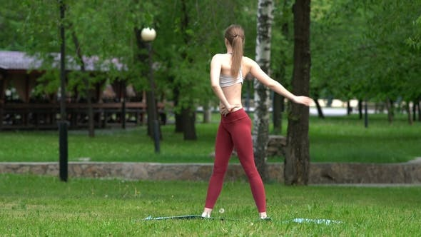 Thumbnail for Young Girl Doing Yoga Exercises in the Park He Stretches, Stretches