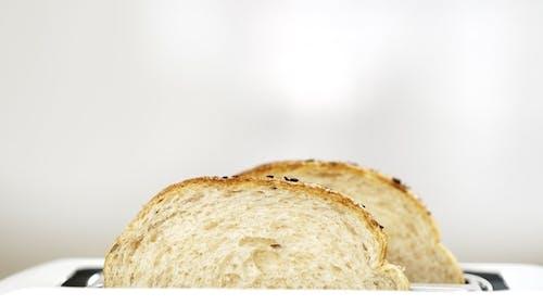 Fresh Bread Putting in White Modern Toaster Machine