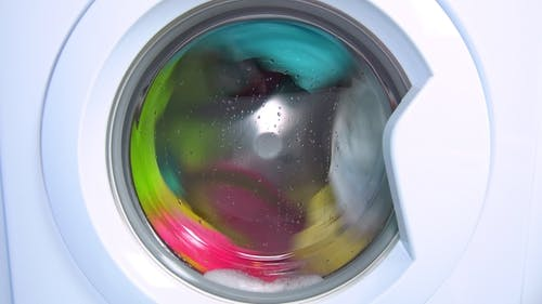 Washing Machine Washes Colored Clothing and Sheets