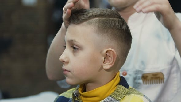 Thumbnail for The Hairdresser Makes a Hairstyle for Her Little Client New Haircut for Boy Barbershop