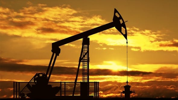 Cover Image for Oil Pump Jack Against Sunset