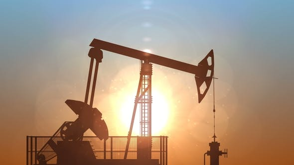 Oil Pump Jack Against Sunrise, Loop