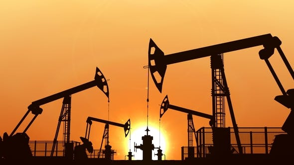Thumbnail for Looped Oil Pumpjacks Against Orange Sunset Sky