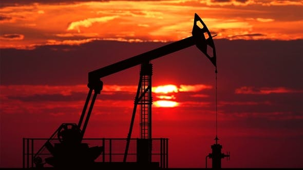 Cover Image for Oil Pump Jack Against Red Sunset