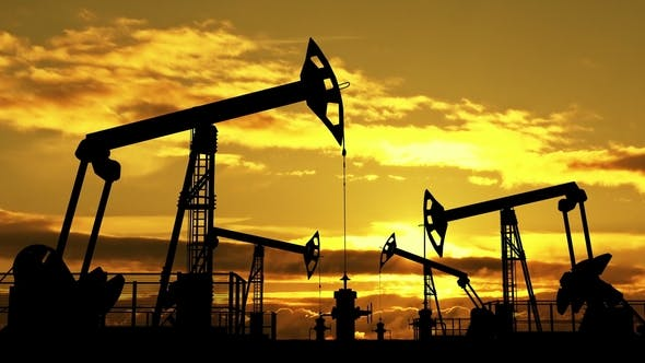 Cover Image for Oil Pumpjacks Against Orange Dusk