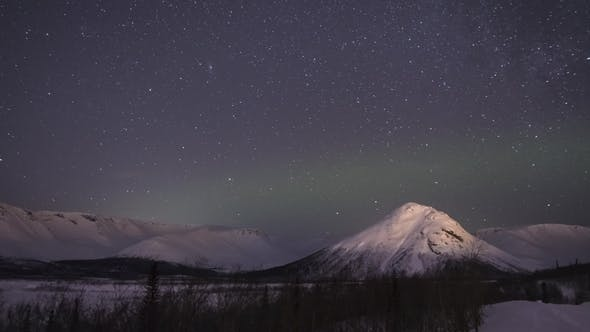 Thumbnail for Night Starry Sky and Green Northern Lights in Snowy Mountains at Winter Night