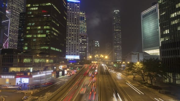 Cover Image for Cars Traffic and Hong Kong Skyscrapers at Night