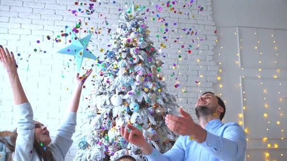 Thumbnail for Family Have Launched Confetti on Christmas Background