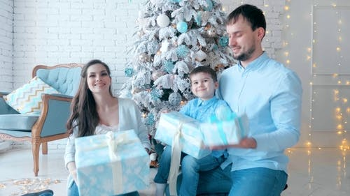 Happy Family Pile up Boxes with Gifts