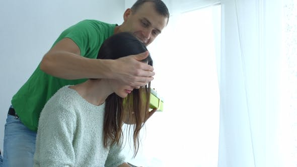 Man Giving Present To Woman on Valentine's Day