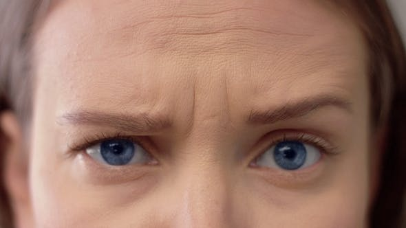 Thumbnail for of Woman s Blue Eyes and Forehead Showing Different Emotions