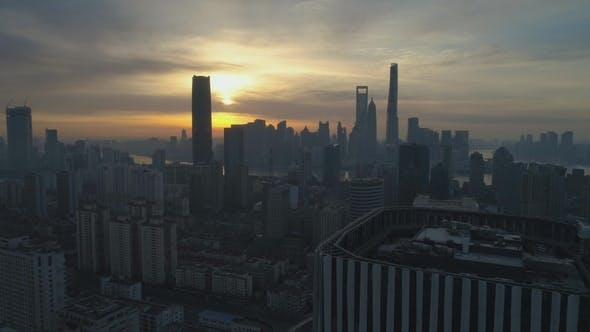 Thumbnail for Shanghai Skyline at Sunrise. Aerial View. China. Drone Is Flying Forward Over The Roof of Skyscraper