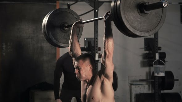 Thumbnail for Man Training with Heavy Barbell in Gym