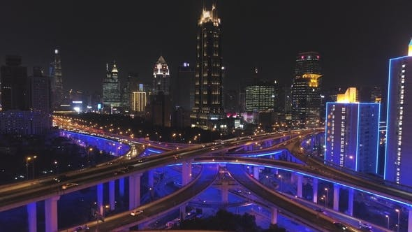 Thumbnail for Elevated Road Overpass at Night with Blue Illumination and Shanghai Cityscape. China. Aerial View