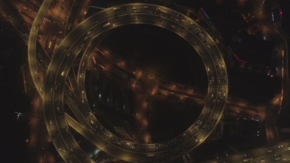 Thumbnail for Spiral Illuminated Elevated Nanpu Highway at Night. Shanghai, China. Aerial Vertical View
