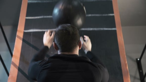 Thumbnail for Athlete Training with Heavy Weight Ball