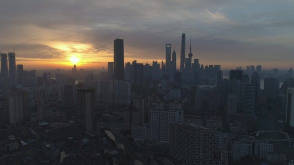 Cover Image for Shanghai Skyline at Sunny Sunrise. Aerial View. China. Drone Is Flying Sideways and Downward