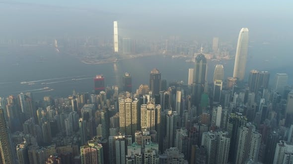 Thumbnail for Hong Kong Skyline and Victoria Harbour. Aerial View. Drone Is Flying Sideways Fast