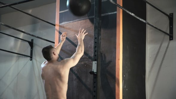 Thumbnail for Sportsman Throwing Weight Ball in Wall