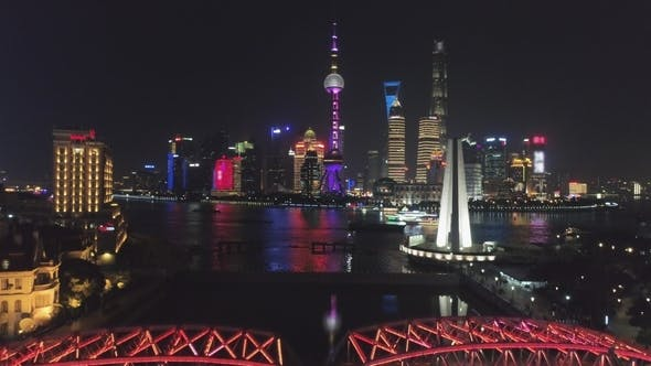 Thumbnail for Illuminated Shanghai Downtown at Night. Lujiazui District and Huangpu River. China. Aerial View