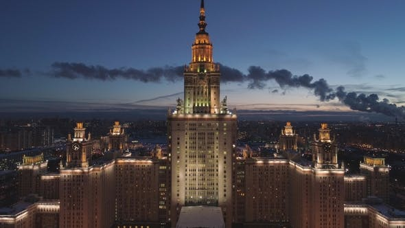 Cover Image for Moscow State University Main Campus and Moscow Cityscape at Winter Twilight. Russia. Aerial View