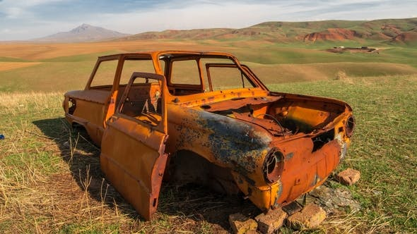 Thumbnail for Orange Rusted Antique Car in the Field