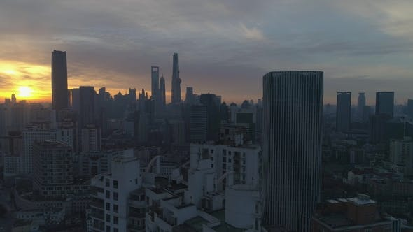 Thumbnail for Shanghai Skyline at Sunny Sunrise. Aerial View. China. Drone Is Flying Sideways and Upward