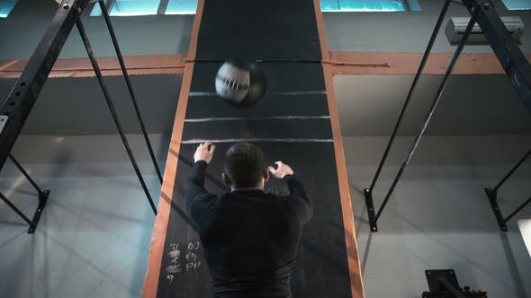 Athlete Training with Heavy Weight Ball